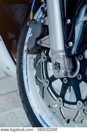 Part Of The Front Wheel Of A Motorcycle. Shock Absorber And Motorcycle Brakes. Part Of A Motorcycle.