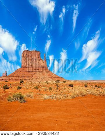 Monument Valley is unique geological formation. The USA. Huge masses of red sandstone - outliers on the Navajo Indian Reservation. Light flying clouds. The concept of active and photo tourism