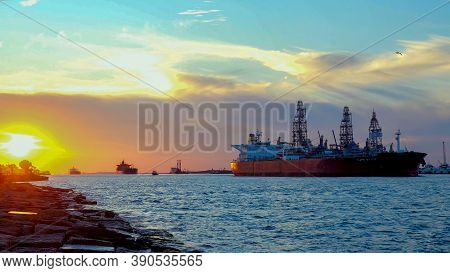Port Aransas, Tx - 21 Feb 2020: Beautiful Sunset With Three Oil Tanker Ships Approaching From Corpus