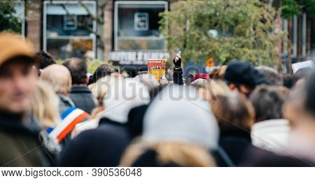 Strasbourg, France - Oct19, 2020: Man Rising History Book Place Kleber To Pay Tribute To History Tea