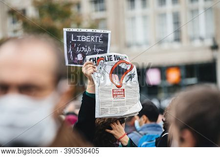 Strasbourg, France - Oct19, 2020: Woman With Charlie Hebdo Newspaper In Place Kleber To Pay Tribute
