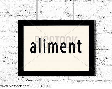 Black Wooden Frame With Inscription Aliment Hanging On White Brick Wall