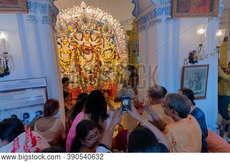 Kolkata, West Bengal, India - 6th October 2019 : Devotee Woman Taking Picture Of Traditionally Decor
