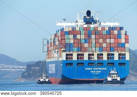 Oakland, Ca - Oct 14, 2020: Multiple Tugboats Assist Cargo Ship Cosco Kaohsiung To Maneuver Out Of T