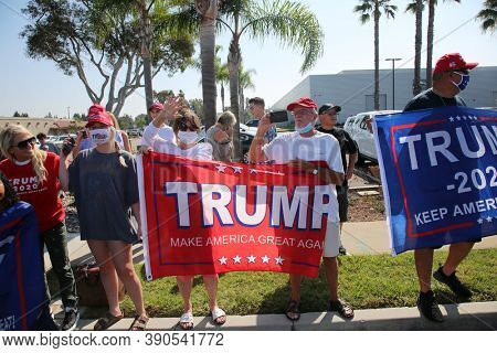 Irvine, California / USA - October 18.2020: Happy President Donald J. Trump Supporters, Wave Flags, Sing, Chant Slogans, Smile and Cheer as they Celebrate President Trump visiting for a Fundraiser.