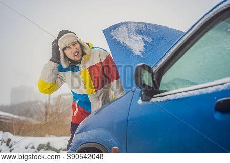 Upset Young Men Looking Under The Hood Broken Car On Winter Road