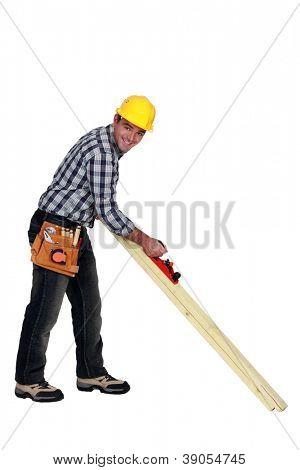 Carpenter using a plane