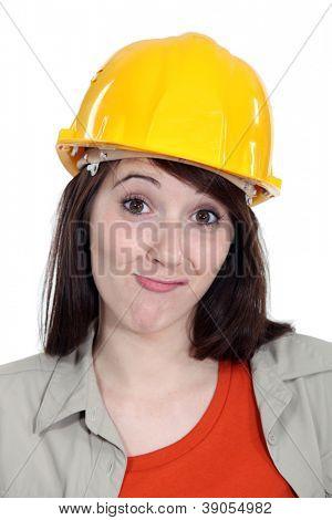 Bemused female builder
