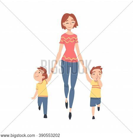 Mother Taking Her Two Little Sons To The School Or Kindergarten In The Morning, Parent And Kid Walki