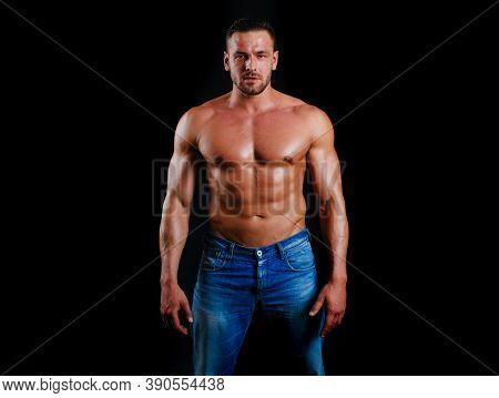 Muscular Shirtless Fashion Male Model. Strong Man. Guy In Vogue Style On A Black Background. Young B