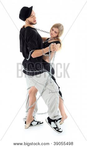 Rapper wearing black t-shirt graceful girl dance twisted with chains isolated on white background.