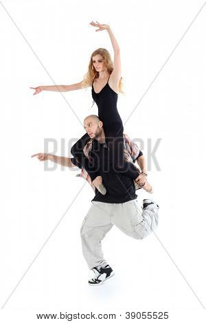 Breakdancer keeps on shoulders ballerina isolated on white background. Man and woman point to left.
