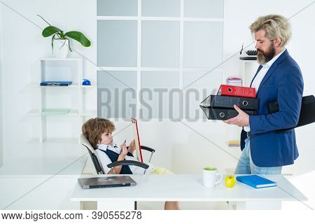 Boss And Employee. Boss And Businessman Working Together In Office. Little Boss And Mature Employee