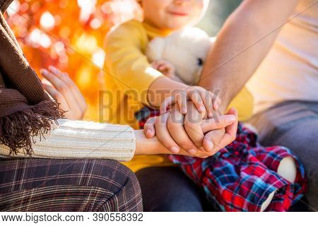 Concept Of Unity, Support, Protection, Happiness. Child Hand Closeup Into Parents. Hands Of Father,