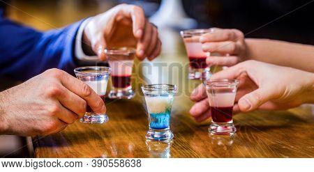 Male Hands Glasses Of Shot Or Liqueur. Friends Drink Shot Or Liqueur. Five Glasses Of Alcohol.tequil