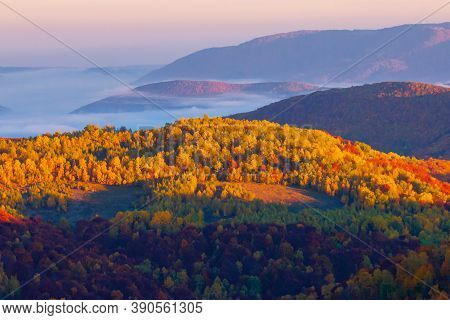 Misty Sunrise In Mountains. Wonderful Autumn Weather. Beautiful Nature Scenery Observed From The Top