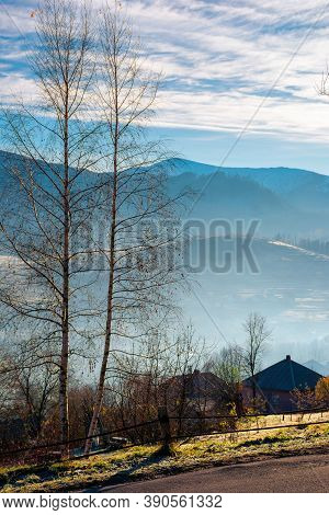 Mountain Road Winding Through Countryside. Beautiful Autumn Scenery At Sunrise. Village In The Valle