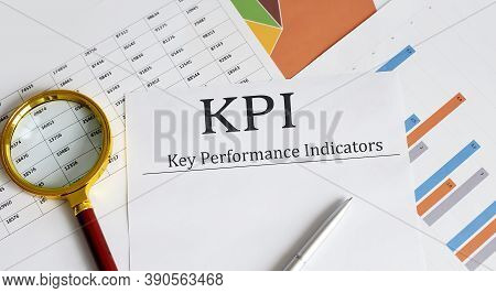 Kpi Key Performance Indicator Text With Magnifying Glass Lens On Office Desk Table. Business Kpi Con