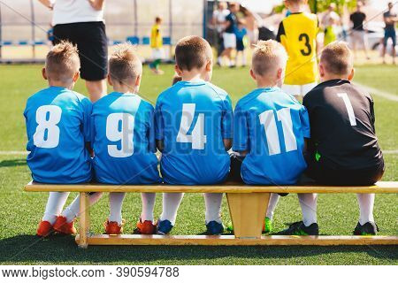 Football Soccer Game For School Boys. Children Substitute Players In A Sports Team In Jersey Shirts