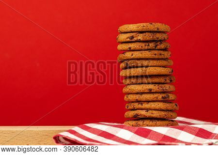 Chocolate Chip Cookies In Stack On Red Background