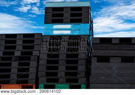 Pile Of Plastic Shipping Pallet. Industrial Plastic Pallet Stacked At Factory Warehouse. Cargo And S