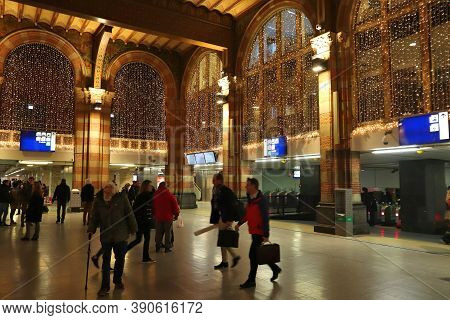 Amsterdam, Netherlands - December 6, 2017: People Visit The Central Train Station In Amsterdam, Neth