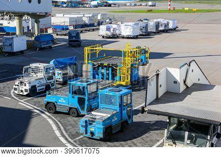Amsterdam, Netherlands, 30/09/20. Airport Ground Handling Support Equipment, Vehicles, Tugs, Stairs,