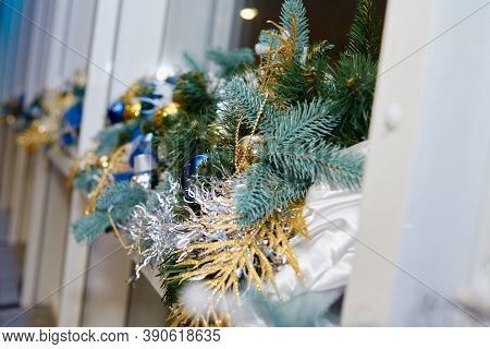 Christmas Decor With Gold And Blue Shiny Baubles And Fir Tree Branches On Window Sill, Copy Space. M