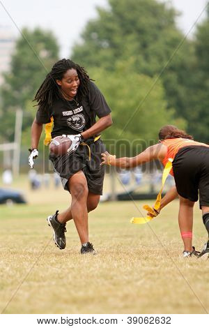 Female Flag Football Player Avoids Defender