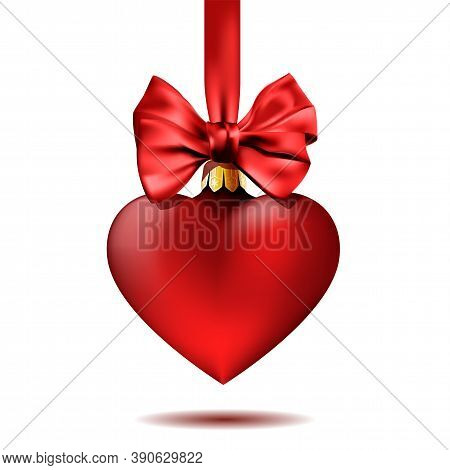 Red Christmas Decoration Shape Of Heart Hanging On Ribbon With Bow.