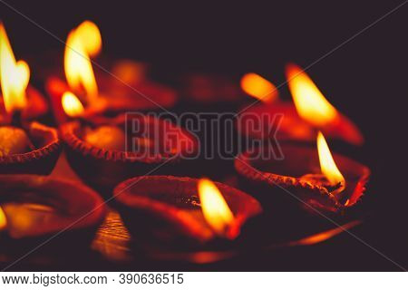 Diwali Diya, Oil Lamps Lit Or Burning On The Festive Occasion Of Deepavali, Deepawali. Background Fo