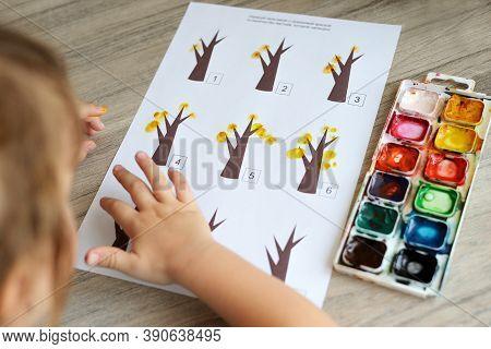 Orenburg, Russia, 10/15/2020: Montessori Material. Children\'s Hands. The Study Of Mathematics And S