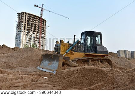 Dozer On Earthmoving At Construction Site. Bulldozer On Road Work. Construction Machinery And Equipm