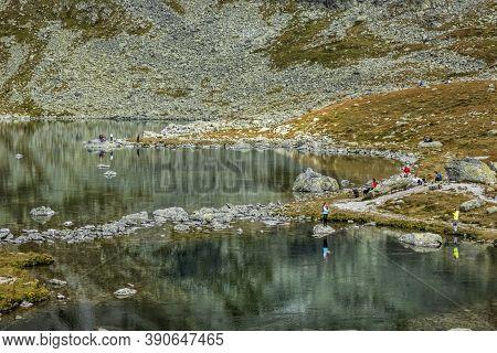 Great Hincovo Tarn With Many Tourists, Mengusovska Valley, High Tatras Mountains, Slovak Republic. H