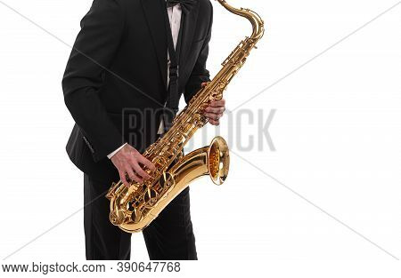 Saxophonist With A Saxophone In His Hands On A White Background.