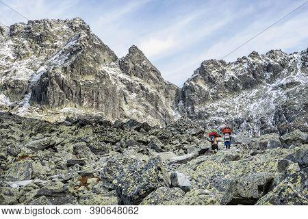 Mountain Carriers Walking To The Mountain Cottage Under The Rysy Peak, High Tatras Mountains, Slovak