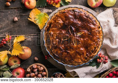 Homemade Apple Pie Surrounded By Fresh Fruits, Nuts, Apples. Apple Pie- Homemade Gourmet Apple Pie