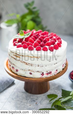 Raspberry Cake. Raspberry Pie. А Piece Of White Cake With Milk Cream Mousse And Raspberry Filling On