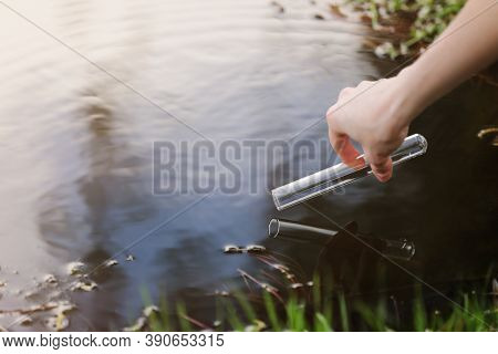 A Water Sample From The River. Water Intake. Water Abstraction. Sample Water. The Concept Of A Clean