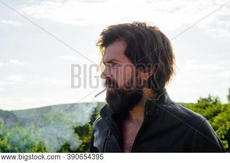 Bearded Man Smoke The Cigarette. Stylish Hipster With Cigarette. Cigarette Smoke. Sensual Man Smokin