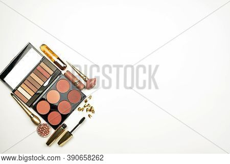 Feminine Beauty Kit On White. From Above View Of Organized Composition With Powder Palettes, Eyeshad