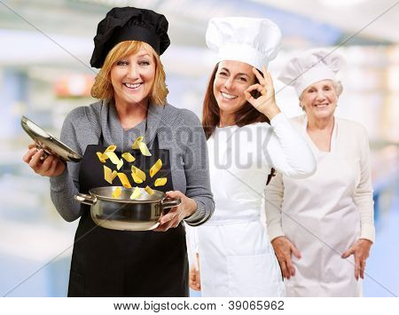 Two Female Chef's Happy With Their Food, Indoors