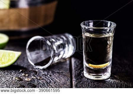Several Glasses With Mezcal (or Mescal) Is Commonly Known As Tequila With Larvae Or Worm, An Exotic