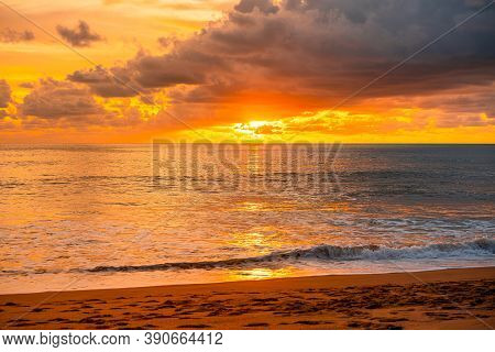 View Of Beautiful Glorious Golden Sunset And Golden Hour Above The Sea In Evening.