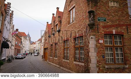 Bruges, Belgium - May 12, 2018:  Roofs And Windows Of Old Authentic Brick Houses On Street Ontvanger