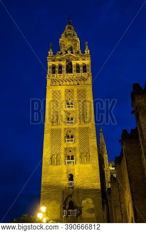 Famous Bell Tower Named Giralda In Catholic Cathedral Of Saint Mary, Catedral De Santa Maria De La S