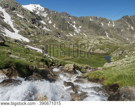 Top View Of Beautiful Wetland With Wild Stream Cascade, Alpine Mountain Meadow Called Paradies With