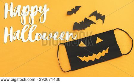 Happy Halloween Text On Evil Face Mask With Jack O Lantern Smile On Orange Background. Halloween 202