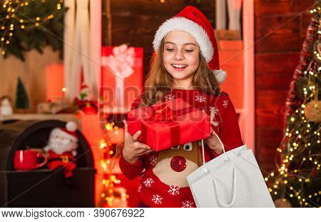 Little Girl With Gifts. Shopping Mall Concept. Excited Child. Sales And Discounts. Winter Shopping.