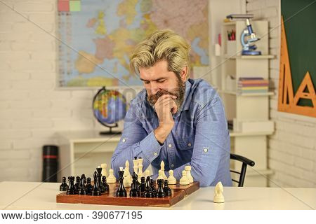 Mind Exercising Activities. Playing Board Game With Friend. Moving Piece During Chess Tournament. Mo